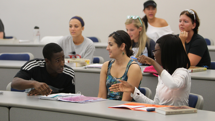 Health Professions Scholars Program students having a discussion.
